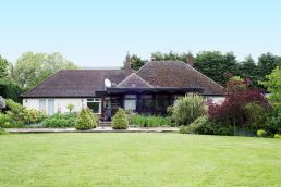 Main farmhouse bed and breakcast pictured from the lawn at Linford Stables B&B Milton Keynes